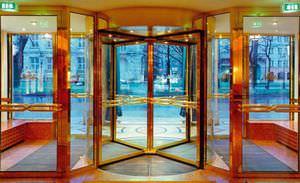 entry door / revolving / wooden / for public buildings