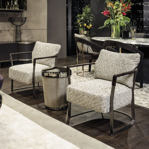 contemporary armchair / fabric / leather / solid wood