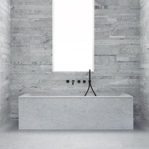 free-standing bathtub / natural stone
