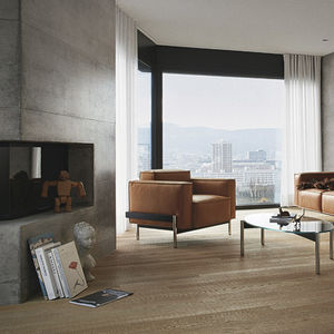 contemporary armchair / fabric / leather / floating
