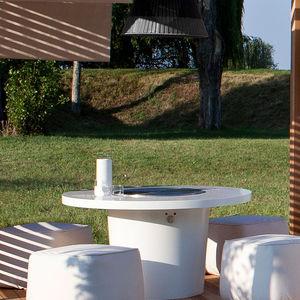 contemporary table / Corian® / round / garden