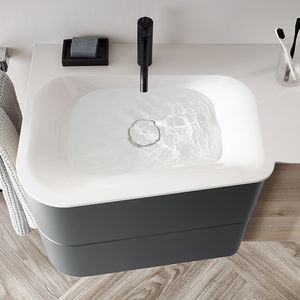 built-in washbasin / mineral stone / contemporary / with counter