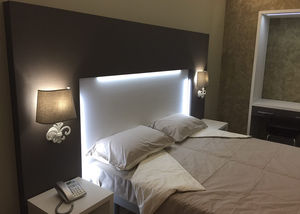 double bed / contemporary / with headboard / with built-in light