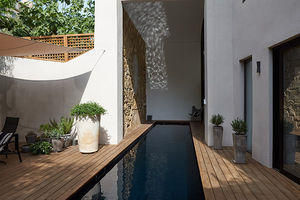 in-ground swimming pool / concrete / wooden / custom