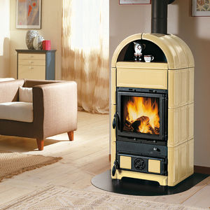 wood heating stove / cast iron / ceramic / traditional