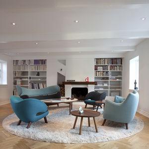 Scandinavian design side table / wooden / round / by Finn Juhl