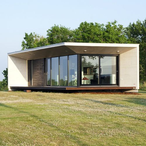 prefab house / modular / contemporary / wooden frame