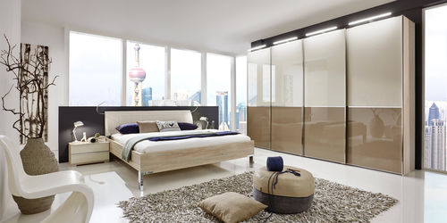 double bed / contemporary / with leather headboard / wooden