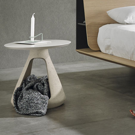 contemporary bedside table / enameled sandstone / round / contract