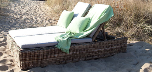 contemporary sun lounger / rattan / wicker / fabric