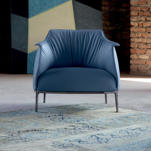 contemporary armchair / leather / cast aluminum / with footrest