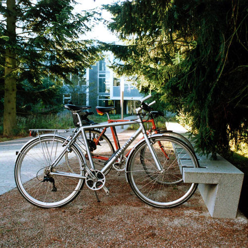 public bench / contemporary / concrete / with integrated bike rack