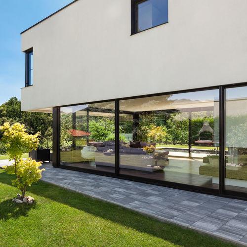 sliding patio door / composite / PVC / double-glazed