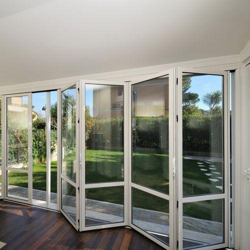sliding and stacking patio door / folding / aluminum / double-glazed