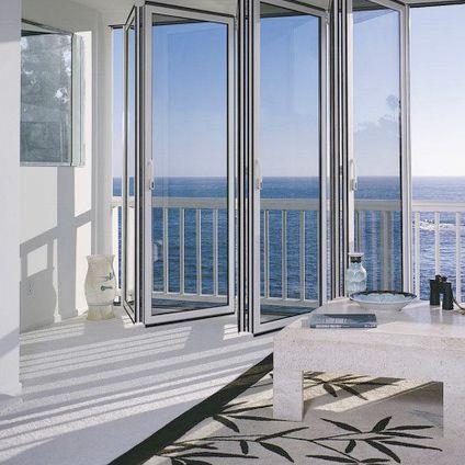 sliding and stacking patio door / aluminum / double-glazed / thermal break