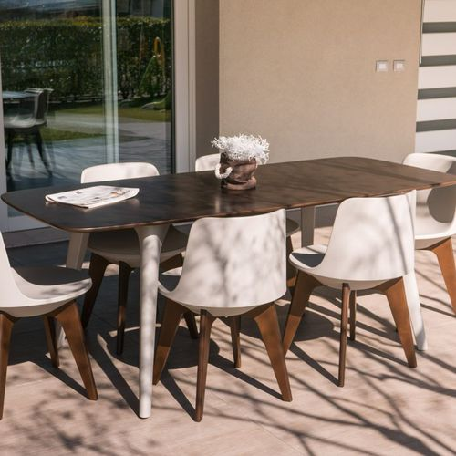 contemporary table / stainless steel / HPL / polyethylene