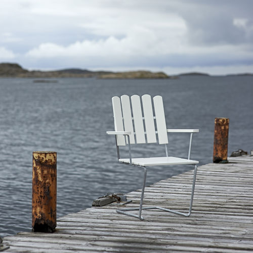 traditional garden chair / with armrests / stackable / cantilever
