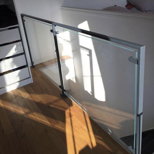 glass railing / steel / glass panel / indoor