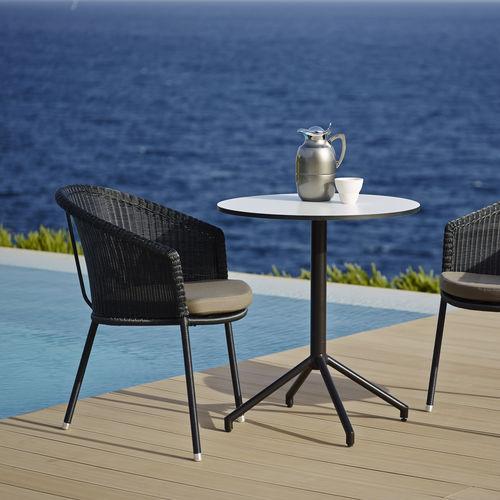 contemporary garden chair / stackable / 3-legged / rattan