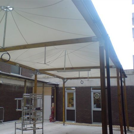 metal and wooden frame tensile structure