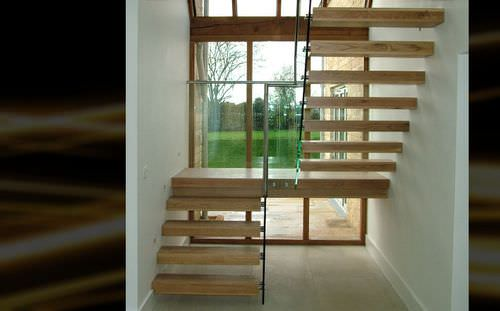 half-turn staircase / straight / metal frame / wooden steps