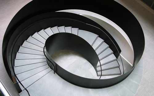 circular staircase / helical / steel frame / stone steps