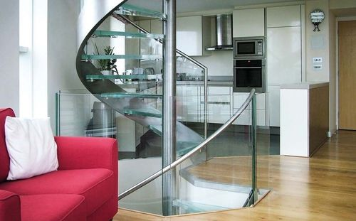 spiral staircase / stainless steel frame / glass steps / without risers