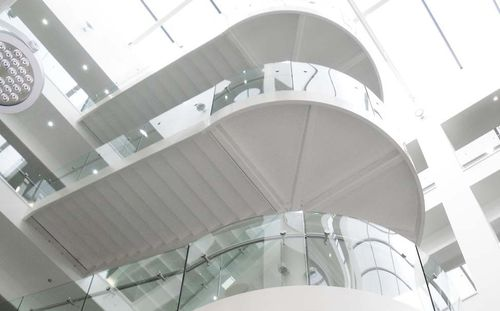 half-turn staircase / stainless steel frame / glass steps / with risers