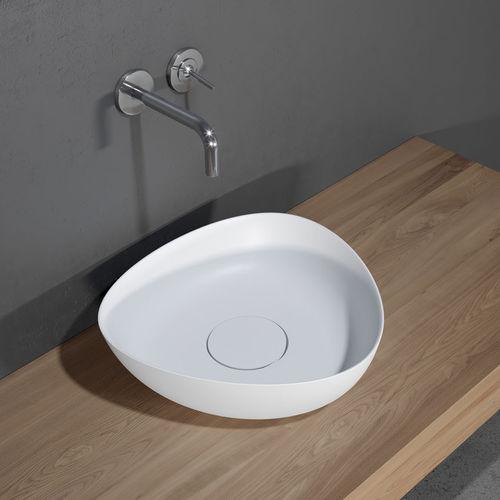 countertop washbasin / triangular / ceramic / contemporary