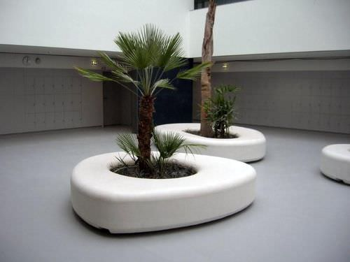 public bench / organic design / concrete / with integrated planter