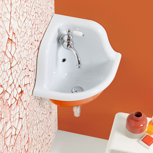 wall-mounted washbasin / corner / ceramic / traditional