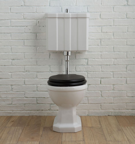 free-standing toilet / ceramic / with low tank