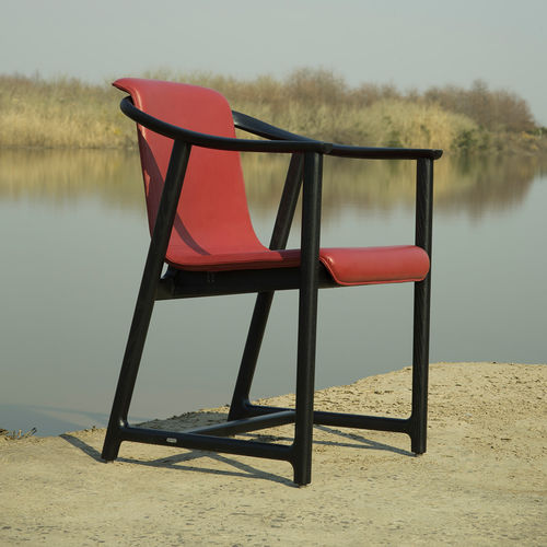 contemporary chair / upholstered / solid wood / stainless steel