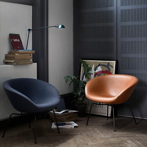 contemporary armchair / fabric / leather / chrome steel