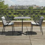 contemporary chair / with armrests / with removable cushion / stainless steel
