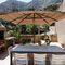 offset patio umbrella / iroko