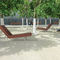 contemporary chaise longue / wooden / for public spaces