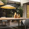 contemporary dining table / walnut / clay / metal base
