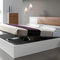 double bed / contemporary / with in-base storage / with integrated bedside table
