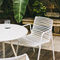 contemporary chair / with armrests / painted aluminum / outdoor