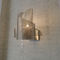 contemporary wall light / polished stainless steel / halogen