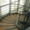 helical staircase / metal frame / wooden steps / without risers
