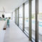 contemporary kitchen / lacquered wood / island / handleless