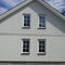 prefab house / contemporary / wooden frame / two-story
