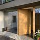 entry door / oak / pivoting / without glazing