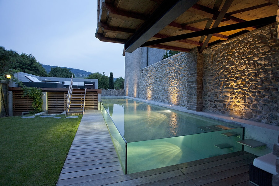 The Excelsior swimming pool with glass walls by Carré Bleu for a ...
