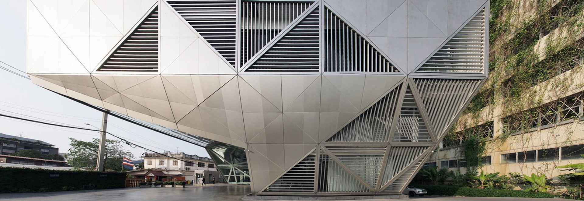ASWA wraps the bitwise headquarters in thailand in a geometric, multi-faceted exterior shell