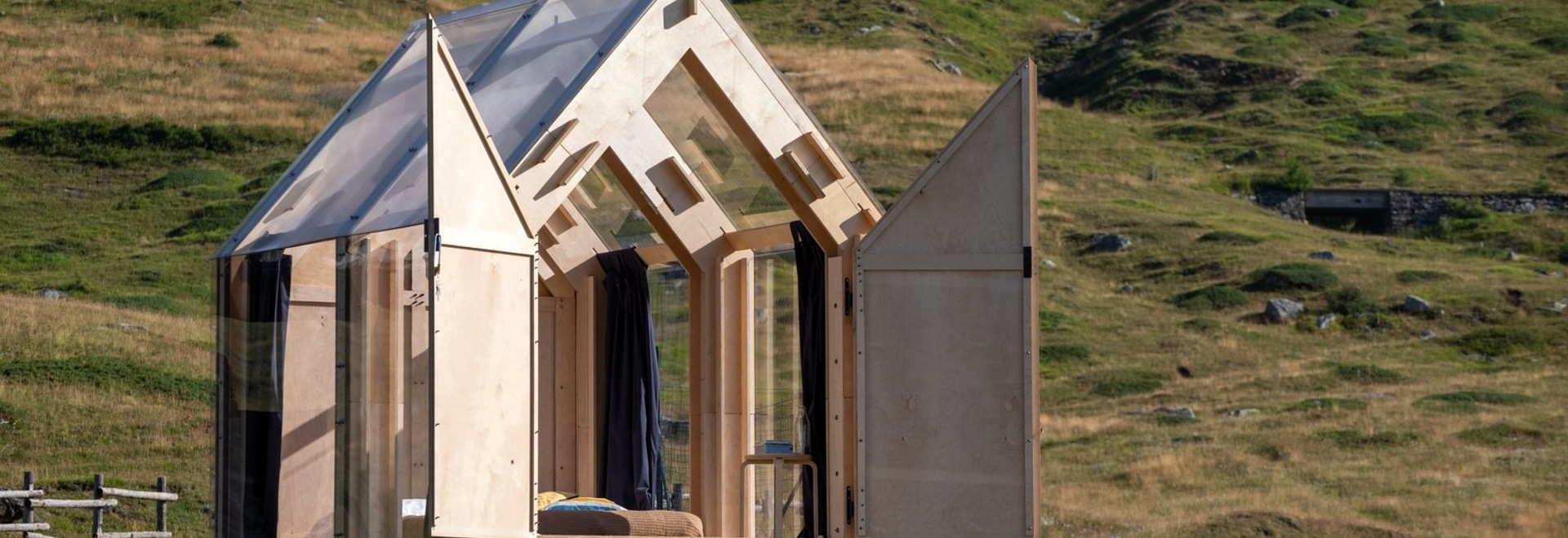 "Birch plywood panels, full-height windows, and a transparent roof compose ""Immerso Glamping"" set in the Italian alpine town of Usseaux."