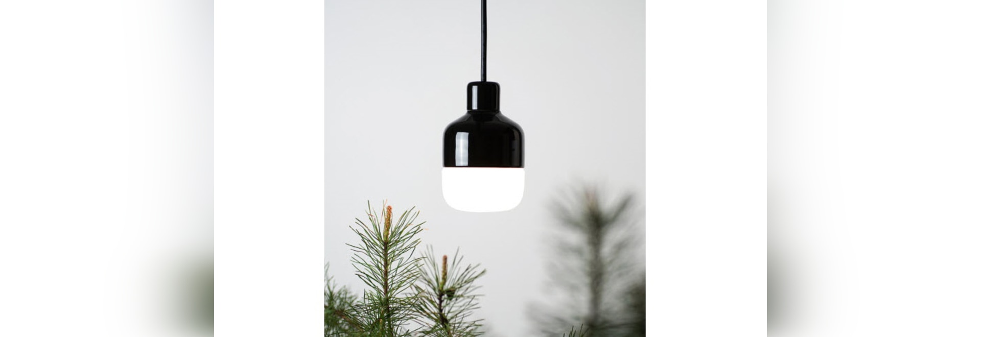 a black high gloss glazed weatherproof porcelain luminaire for outdoor use