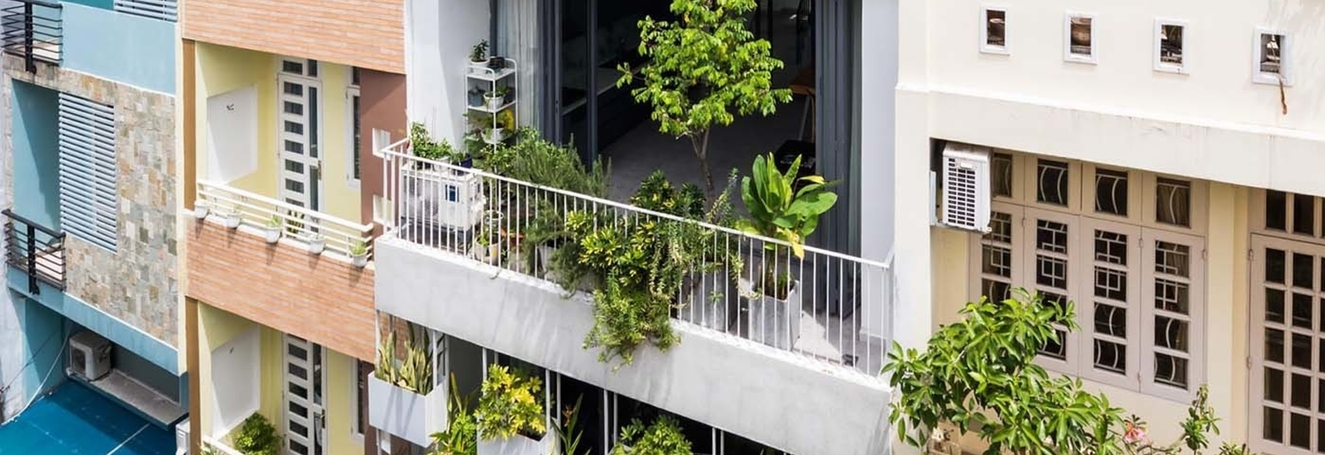 Built-In Planters Add Privacy And Greenery To This Home's Exterior